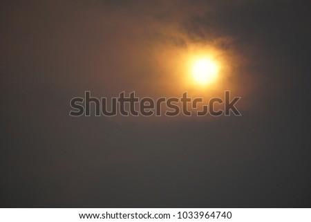 Big sun , sun set dark background. #1033964740