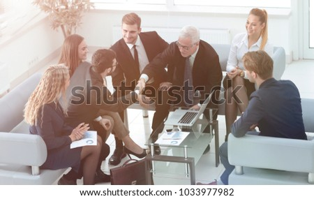 business partners shake hands at a business meeting in the offic #1033977982