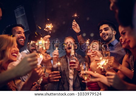 Group of friends celebrating at the nightclub #1033979524