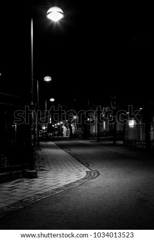 black and white image of street lights #1034013523