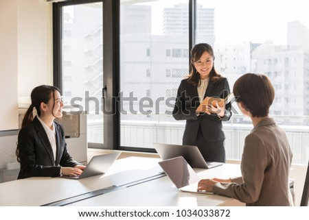 asian businesswoman working in office #1034033872