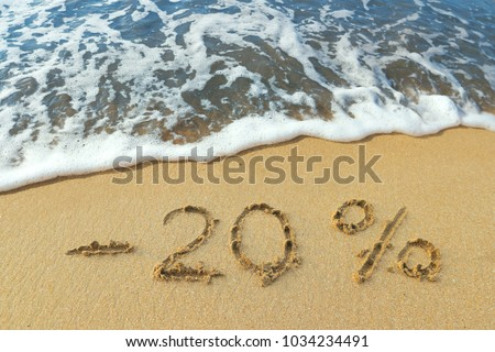 The inscription minus twenty percent off on the sand near the ocean. Discount on vacation at the sea. #1034234491