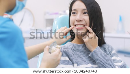Woman talk to dentist in dental clinic  #1034240743