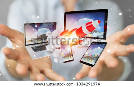 Businesswoman on blurred background connecting tech devices and startup rocket 3D rendering #1034291974