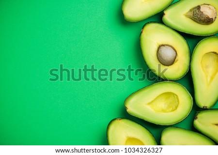 Avocado on pastel background,creative food concept.