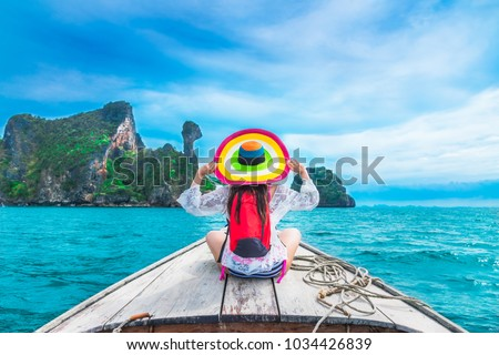 Summer lifestyle traveler woman in bikini and big hat joy relaxing on boat, Kai island, Andaman sea, Krabi, Travel Thailand, Beautiful destination landscape Asia, Summer holiday outdoor vacation trip #1034426839