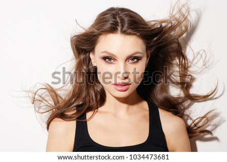 Portrait beautiful young woman with long brown hair. #1034473681