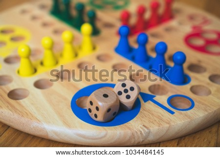 Ludo board family game. Close-up view. #1034484145