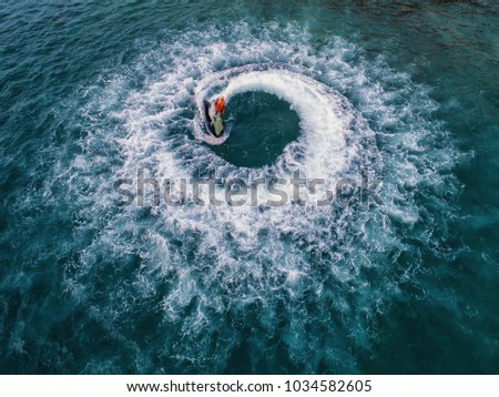 People are playing jet ski at sea during the holidays. #1034582605