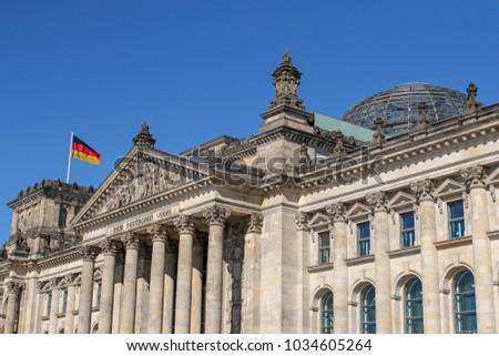 facade of Reichstag building in Berlin, Germany #1034605264