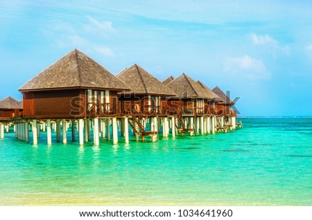 Exotic wooden houses on the water #1034641960