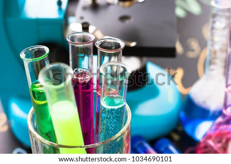 Chemistry class makes chemistry experiment. STEM. Robotics, mechanic, chemistry, biology. Modern education. Fun and interesting Blackchark board background Royalty-Free Stock Photo #1034690101