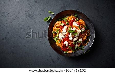 Spaghetti with Fresh Tomato Sauce, Mozzarella and Basil Royalty-Free Stock Photo #1034719102