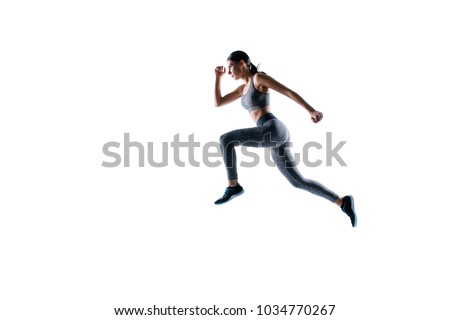 Ready steady go! Concept of endurance strength persistence in sport. Full length full size portrait of beautiful sporty energetic active purposeful sportswoman running and jumping, natural light #1034770267