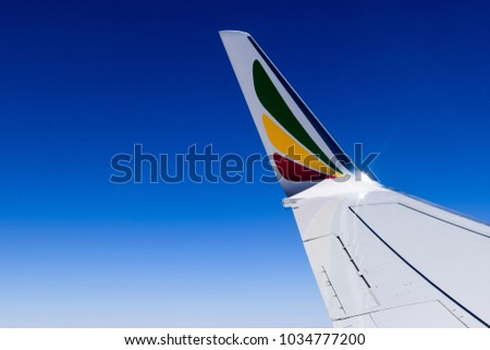 Seychelles, Mahe - 11 June 2016. Ethiopian airlines plane wing in clear and blue sky #1034777200