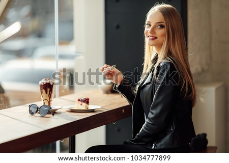 Pretty girl hold a plate of delicious cake and waer glasses. Sun shine photo with girl eat her cake #1034777899