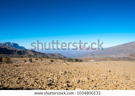Jebel Shams (mountain of sun) is a mountain located in northeastern Oman north of Al Hamra town. It is the highest mountain of the country and part of Al Hajar Mountains range. #1034800132