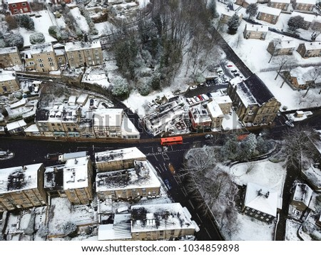 Aerial view of snow falling on Ripponden, Calderdale, West Yorkshire, UK #1034859898