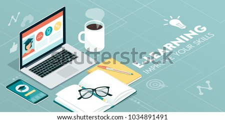 E-learning platform and online courses on a laptop and smartphone: innovative education concept Royalty-Free Stock Photo #1034891491