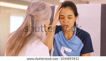 A concussed soccer player seeks help at the doctors office #1034893411
