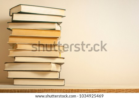 Stack of books on the wooden table. Education background.Back to school. Copy space for text. #1034925469