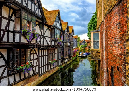 Medieval half-timber houses and Stour river in Canterbury Old Town, Kent, England Royalty-Free Stock Photo #1034950093