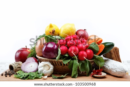 Healthy food. Fresh vegetables and fruits on a wooden board. #103500968