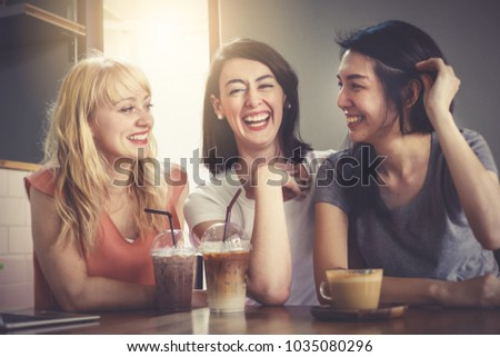 Background of a happy group of close friends chatting and talking over lunch in coffee shop. Beautiful pretty caucasian and asian women sitting together very enjoy and laughing with smile in holidays #1035080296