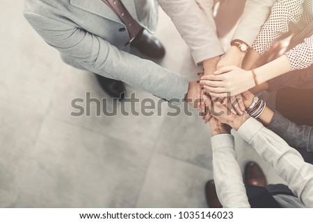 Group of successful business people hand to hand #1035146023