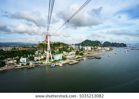 Halong city aerial view with Bai Chay bridge in Quang Ninh province, Vietnam Royalty-Free Stock Photo #1035213082