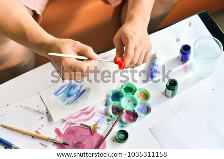 Creative artist workspace top view. Background of painting, art stationery #1035311158