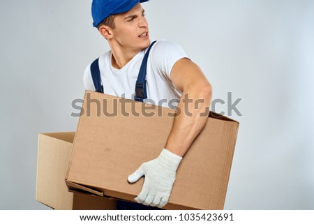 delivery man with boxes, relocation                               #1035423691