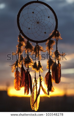 Dream-catcher with sunset on the background