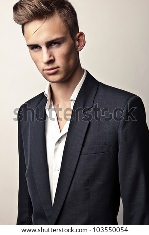 Elegant young handsome man. Studio fashion portrait. #103550054