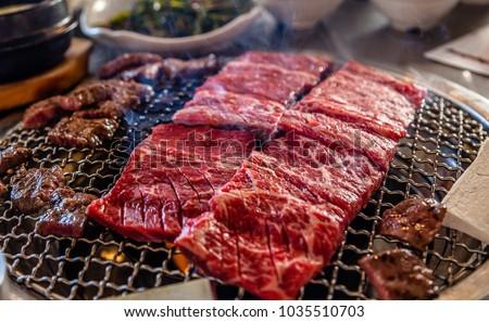Sizzling Korean BBQ Royalty-Free Stock Photo #1035510703