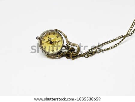 yellow old watch #1035530659