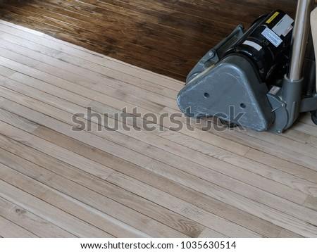 Sanding hardwood floor with the grinding machine Royalty-Free Stock Photo #1035630514
