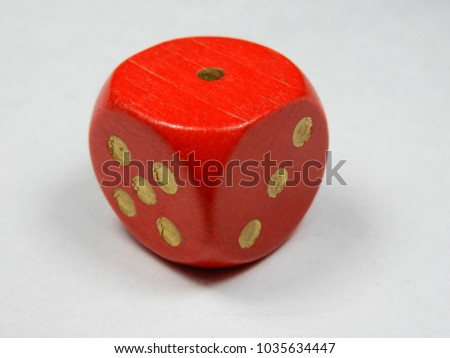 a single wooden red dice #1035634447
