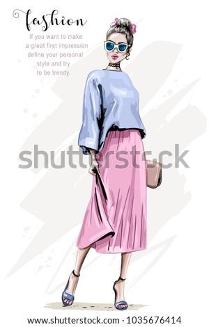 Hand drawn beautiful young woman with handbag. Fashion woman. Stylish cute girl in sunglasses. Sketch.