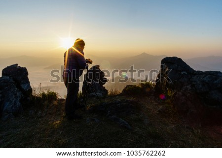Men who are taking nature pictures Sunset time, silhouette #1035762262