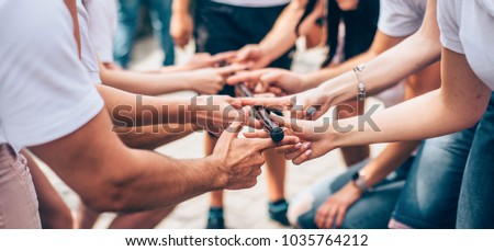 teambuilding activity with stick and hands colleagues Royalty-Free Stock Photo #1035764212