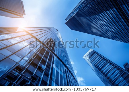 Skyscrapers from a low angle view in modern city of China Royalty-Free Stock Photo #1035769717