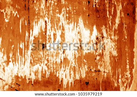 Weathered painted metal wall in orange color. Abstract background and texture. #1035979219