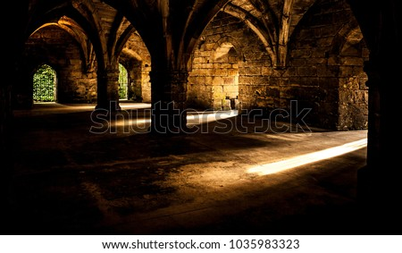 Castle chamber flooded with golden sun. Sun rays and shadows. Big contrast.