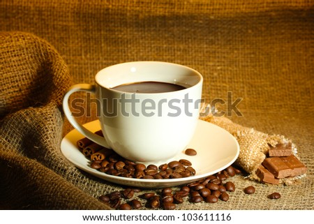 cup of coffee, beans and chocolate on sacking background #103611116