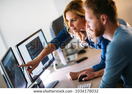 Software engineers working on project and programming in company #1036178032