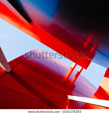 Wide angle abstract background view of steel light blue high rise commercial building skyscraper made of glass exterior. concept of successful industrial architecture and office center building #1036278283