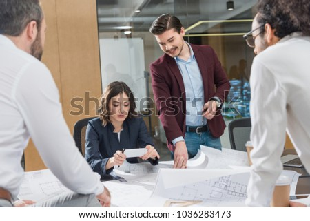 group of architects working together on building plans at office #1036283473