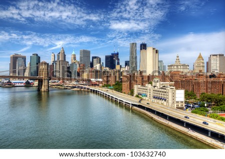 Brooklyn Bridge spans the East River towards Lower Manhattan in New York City. #103632740