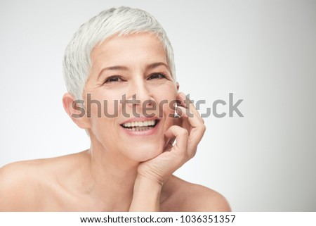 Portrait of beautiful senior woman in front of white background. #1036351357